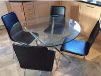 Circular glass table with 4 chairs