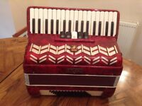 Red Parrot Studio Accordian in good condition in its own hard case carrier