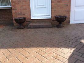 2 brown ornamental patio pots