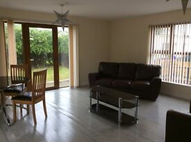 Two bedroom house 2miles from Randalstown and motorway. Living area with dining .