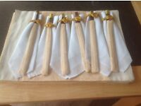 Set of 6 chopsticks with 6 gold & beige place settings.