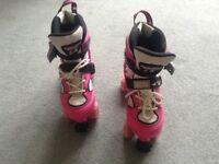 Pink & white roller skates