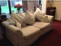 Three seater, pale blue, cushion back sofa.