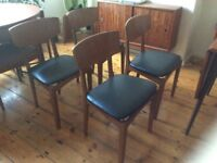 Vintage English mid century dining table and four chairs.