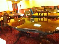 Dining table for sale. Sits 6/ 8. Ornate inlay and carved pedestals.