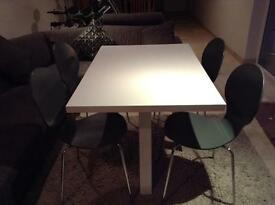 White high gloss tables with graphite chairs