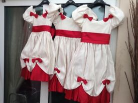 One maid of honour dress and three bridesmaid/ flower girl dresses