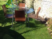 Lovely circular glass table and 4 chairs