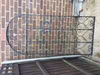 Wrought iron metal scroll gate