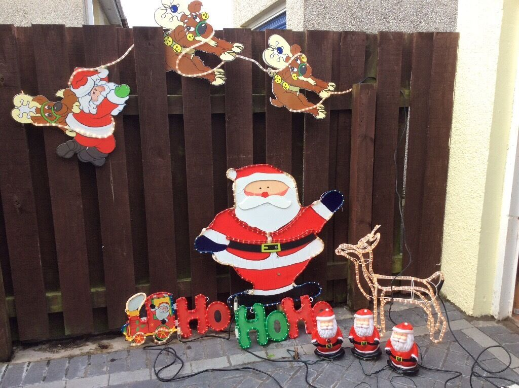 5 outdoor christmas ornaments and 3 indoor all light up sensor dancing santas