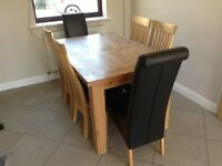 Natural solid oak dining table and six chairs
