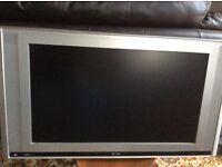 """Silver 27"""" flatscreen TV with tilting wall bracket"""