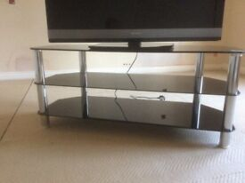 "Glass TV stand suitable for a 40"" television."