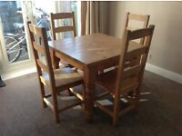 Reclaimed solid pine dining table and four chairs