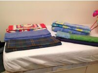 Assorted single duvet covers.