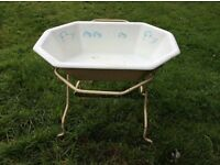 A vintage Baby bath with stand