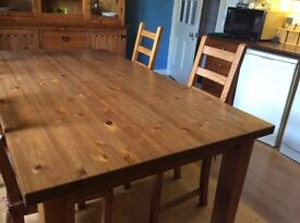 Large table 72 inches long and 32 inches wide. Four chairs. All items are in excellent condition.