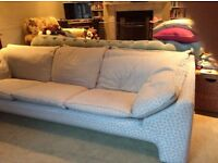 Must sell. Any offers. Four seater sofa quality wooden frame. Covered in Laura Ashley material.