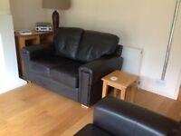 2 steinhoff leather sofas for sale