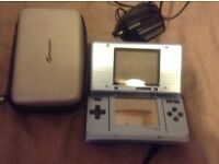 Nintendo DS console in blue with charger and case