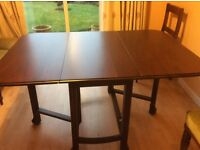 Antique drop leaf dining table. Easily seats 6. Excellent condition.