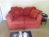 Two X two seater sofa workshop sofas. Terracotta coloured and in good condition.