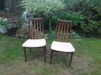 Pair of teak wood dining chairs. Good condition.
