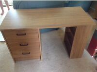Desk with 3 drawers and 3 shelves.