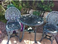 Ornamental garden table and 2 chairs