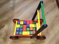 Wooden baby walker with wooden ABC bricks