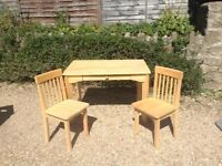 Attractive pine desk with chairs