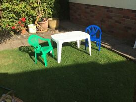 Child's plastic table and chairs