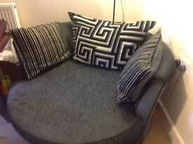 Black and grey round swivel chair for sale.