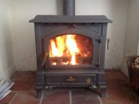 Wood burning Multi Fuel stove 8 kW. Easy to light and control. Good condition.