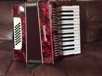 Vintage accordion Worldmaster, made in Germany. In lovely condition, comes with original case.