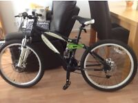 """Childs CARRERA detonate 24"""" bike . Ages 7-9 yrs in as new condition and safety checked by Halfords."""
