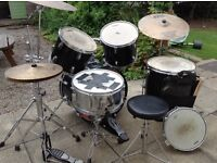 Peavey 5 piece drum Kit. Cymbals and extra piccolo snare. Cowbell and drum stick bag holder.