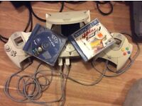 Sega Dreamcast power wire only but with controllers and games