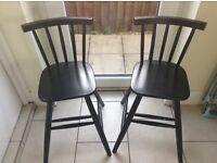 Two black wooden childrens chairs - small but table height