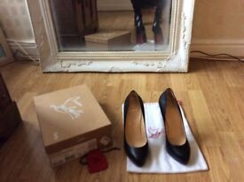 Stunning genuine Christian Louboutin high heel shoes, black with signature red sole. Worn for 1 hour