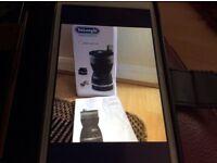New/unused DeLonghi Coffee Grinder. Model - KG49