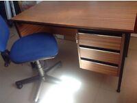 Dark wood desk with drawers