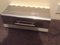 Cream and stainless steel bread bin