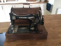 1913's Singer Hand cranked sewing machine with original cover, carrying Case and key.
