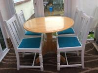 Lovely solid wood dining kitchen table and 4 solid oak chairs