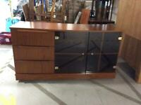 Sideboard with tinted glass doors and casters NEEDS ATTENTION (100% profits go to SPH)