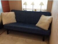 Blue sofa bed, open to small double with spring mattress and space for quilts underneath