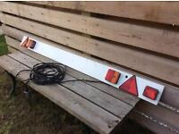 Boat trailer lights and number plate holder