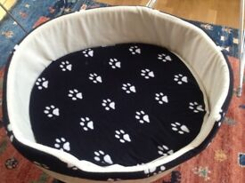 Dog bed never used and a free human cushion
