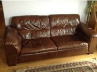Dark brown leather three seater settee. Excellent condition.